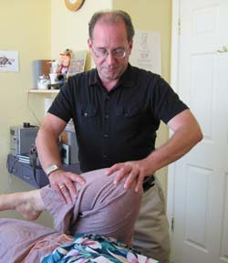 Dr. Erskine DO treating a patient with Osteopathy